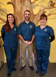 Dr. Shepphard with two team members.